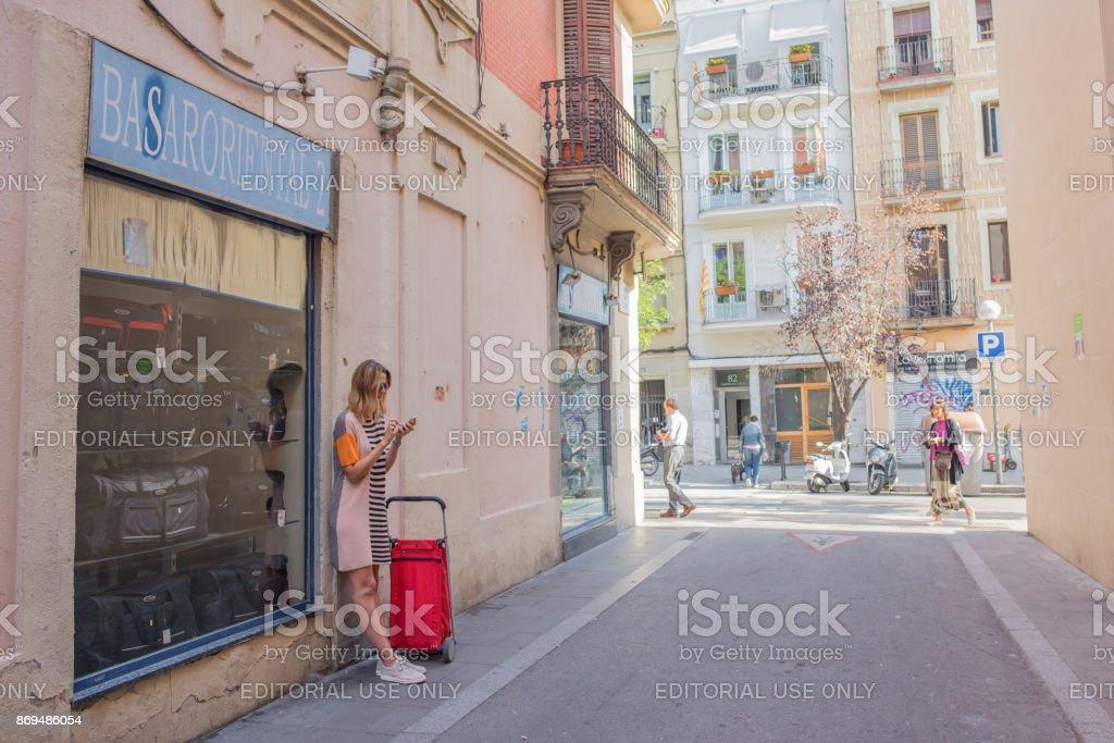 Traveling woman in Gracia, Barcelona stock photo