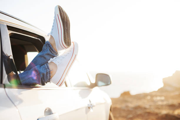 Traveling woman resting in the car stock photo