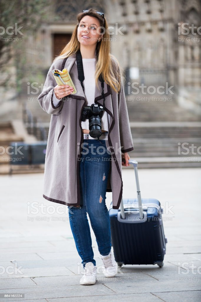 Traveling woman walking in the city royalty-free stock photo