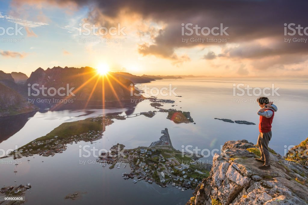 Traveller enjoy summer view of Lofoten Islands in Norway with sunset scenic royalty-free stock photo
