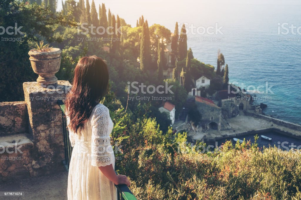 Traveller enjoys scenic view of Trsteno, Croatia. stock photo