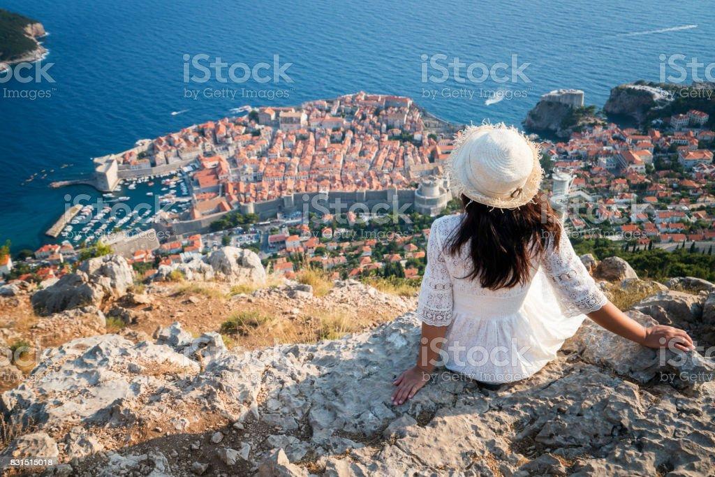 Traveller looking at view of Dubrovnik, Croatia stock photo