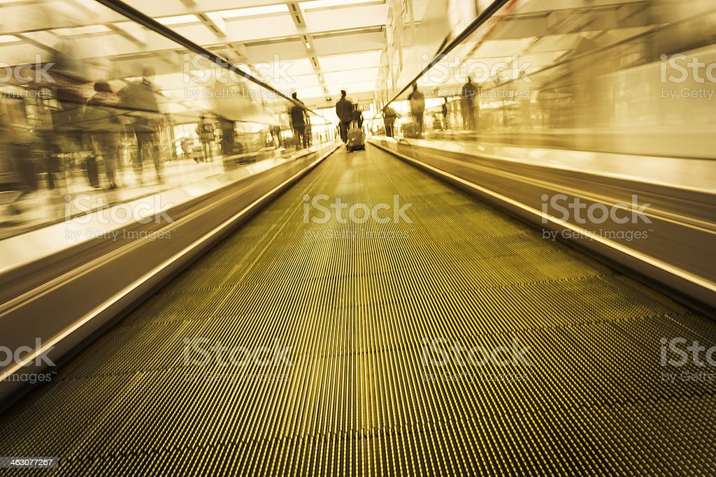 Traveller through airport by walkway royalty-free stock photo