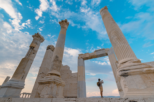 Traveller tourist photographer is taking photo in ancient ruins of Laodicea on the Lycus , Pamukkale