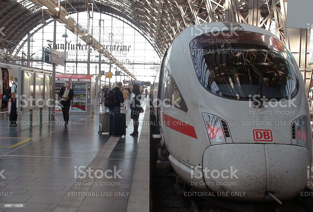 Traveller Trying To Get Information From Deutsche Bahn Train Conductor.Frankfurt.Germany.Europe stock photo