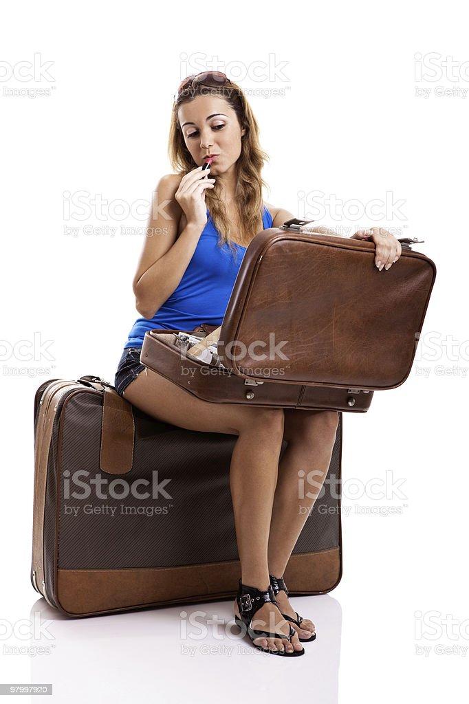 Traveller woman applying makeup royalty-free stock photo
