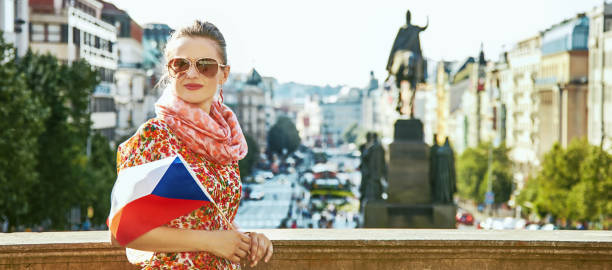 traveller woman on Vaclavske namesti in Prague with Czech flag The spirit of old Europe in Prague. modern traveller woman on Vaclavske namesti in Prague, Czech Republic with Czech flag wenceslas square stock pictures, royalty-free photos & images