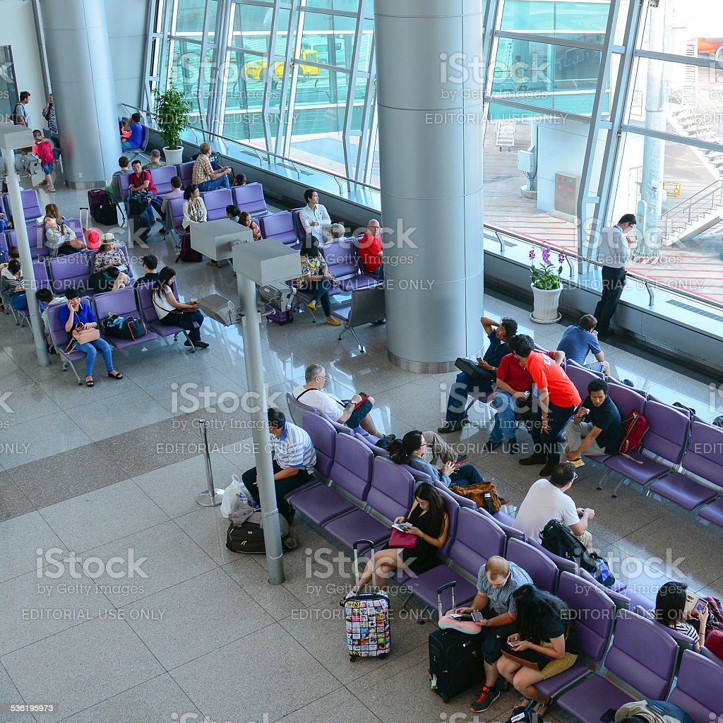 Travellers at departure terminal stock photo
