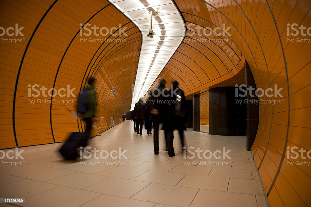 travellers in modern subway tunnel XL royalty-free stock photo