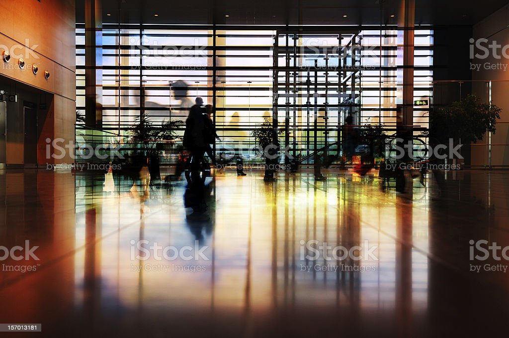 Travellers in silhouette, airport terminal royalty-free stock photo