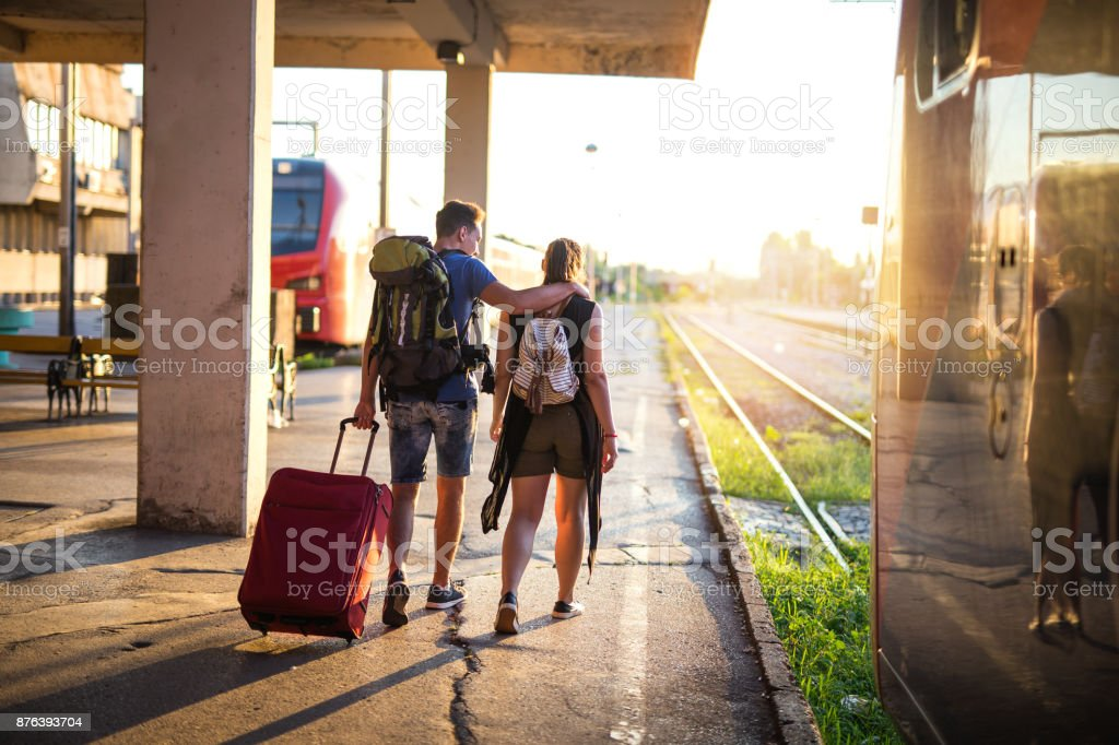 Travellers moving through station stock photo
