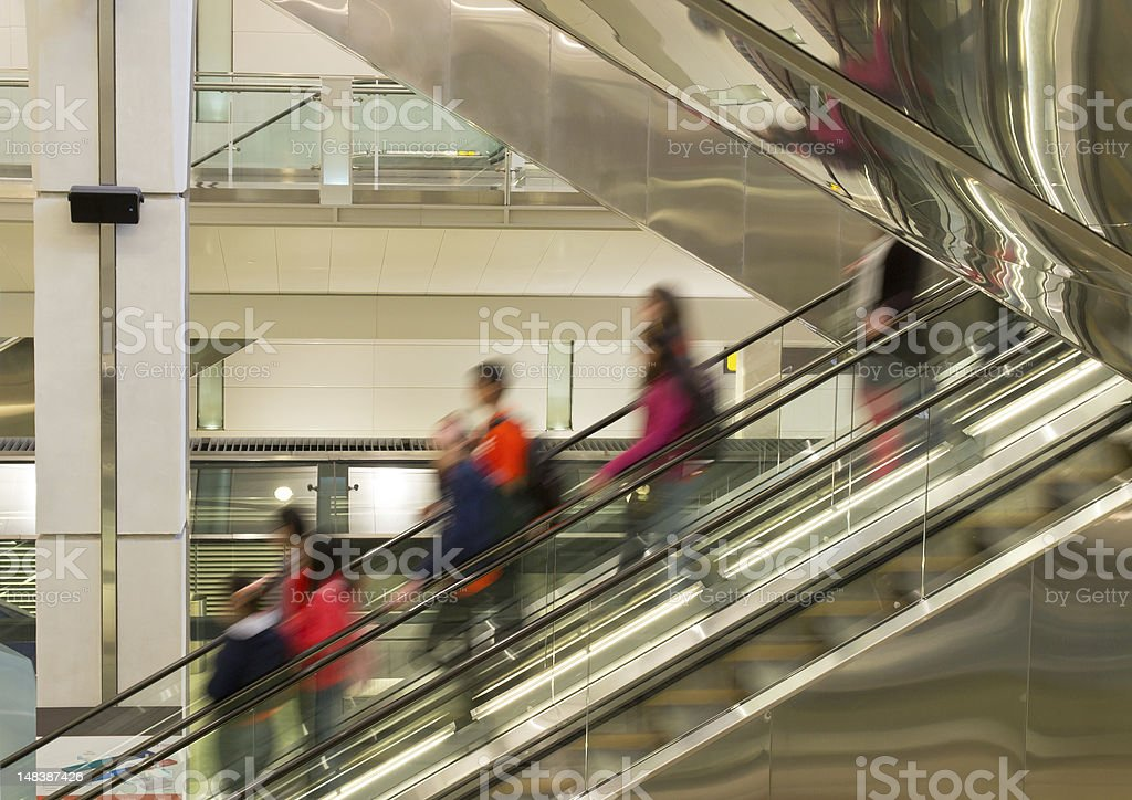 Travellers on the Stairways moving down stock photo