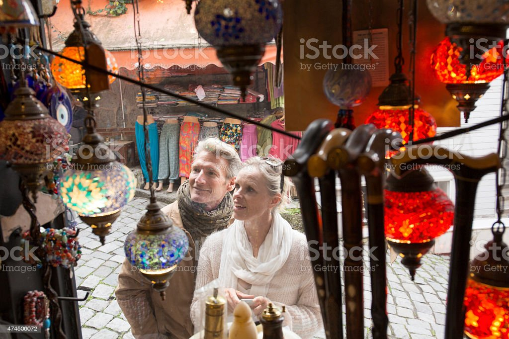 Travellers shop for handicrafts in bazaar stock photo