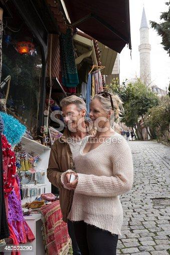 Travellers shop for handicrafts in bazaar, Istanbul