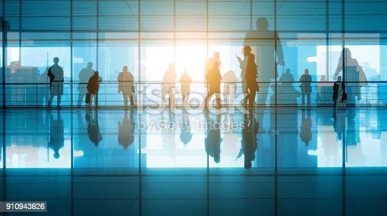 travellers walking in modern airport hallway