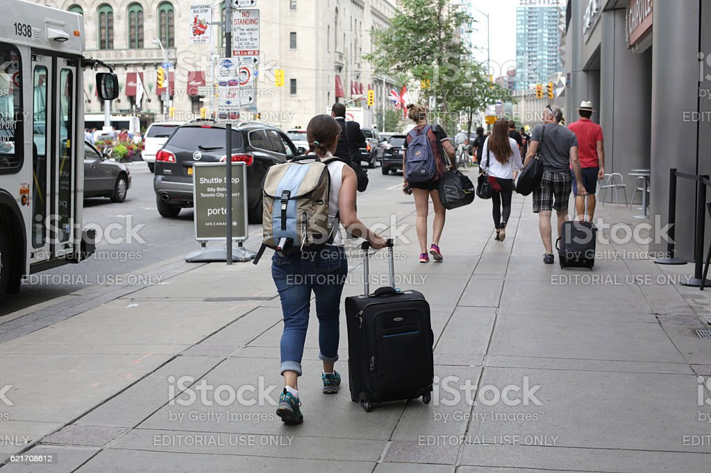Travellers Walking on Front Street, Downtown Toronto, Canada in Summer stock photo