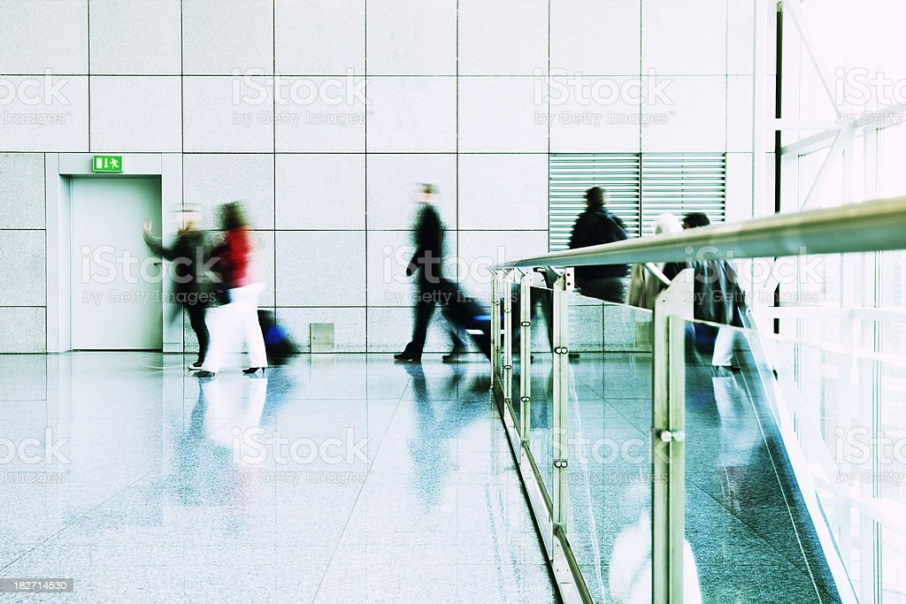 Travellers Walking, Pulling Luggage, Blurred Motion stock photo