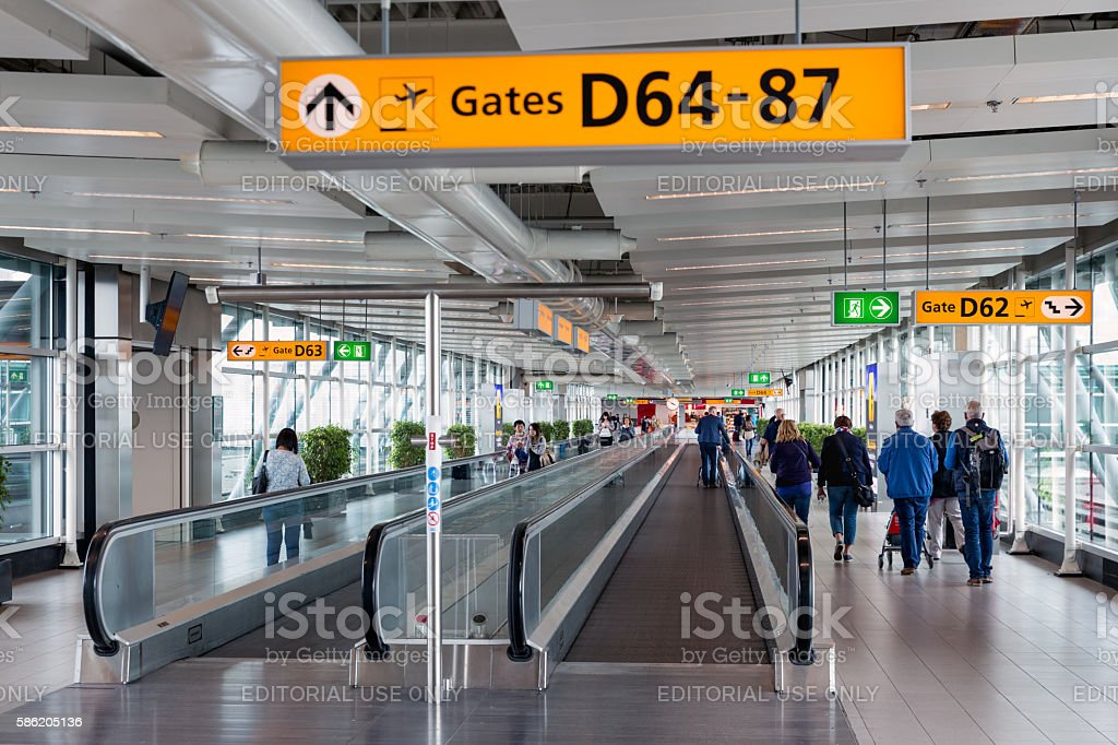 Travellers walking to the gate at Schiphol Airport, The Netherlands stock photo