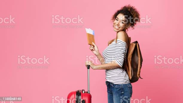 Travelling abroad happy afro woman with passport picture id1155046145?b=1&k=6&m=1155046145&s=612x612&h=mhnt1pwxxs3qkn2rdhhac9x dtsvwwgg2msen892 ce=