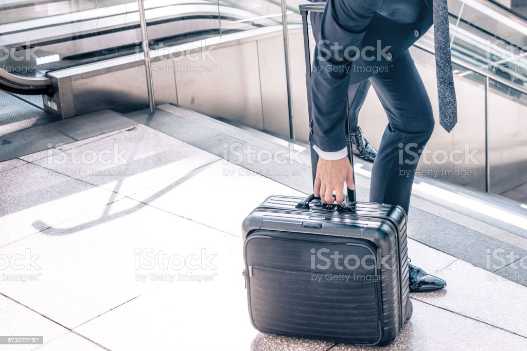 travelling businessman with baggage on stairs in berlin station stock photo