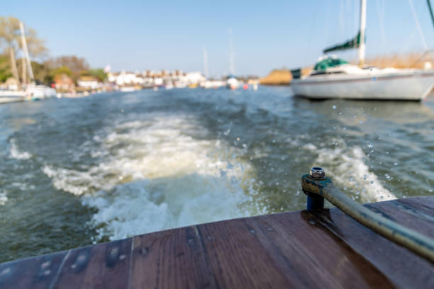 Travelling by small boat with outboard motor stock photo