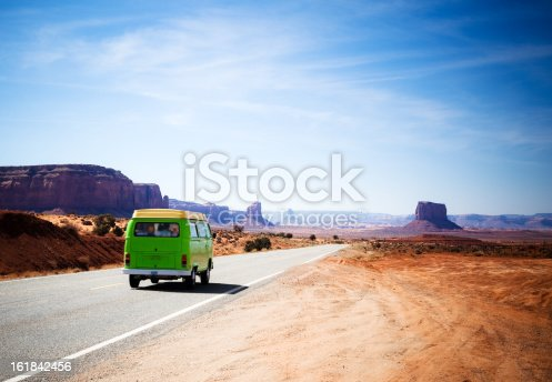 istock Travelling in the Monument Valley With a Green Old Van 161842456