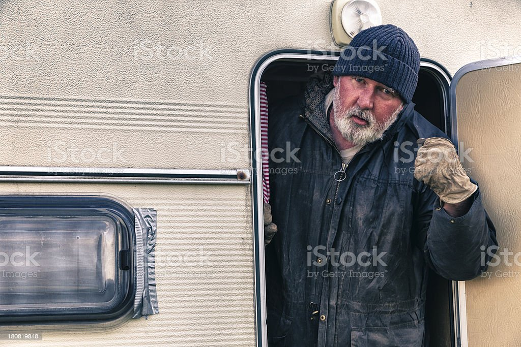 Travelling Man Greets Unwelcome Visitors royalty-free stock photo