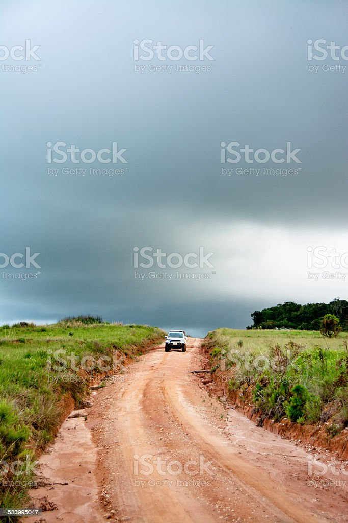 Travelling Offroad in Stormy Weather stock photo