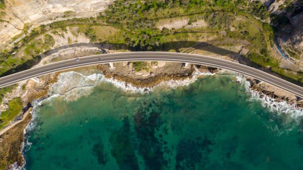 Travelling on the sea cliff bridge coastal drivel along the pacific ocean. Grand pacific drive, East coast of Australia stock photo