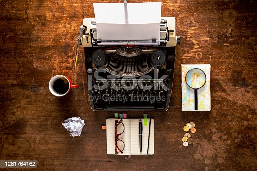 Travelling tools. Retro typewriter travel items on a old wooden desk