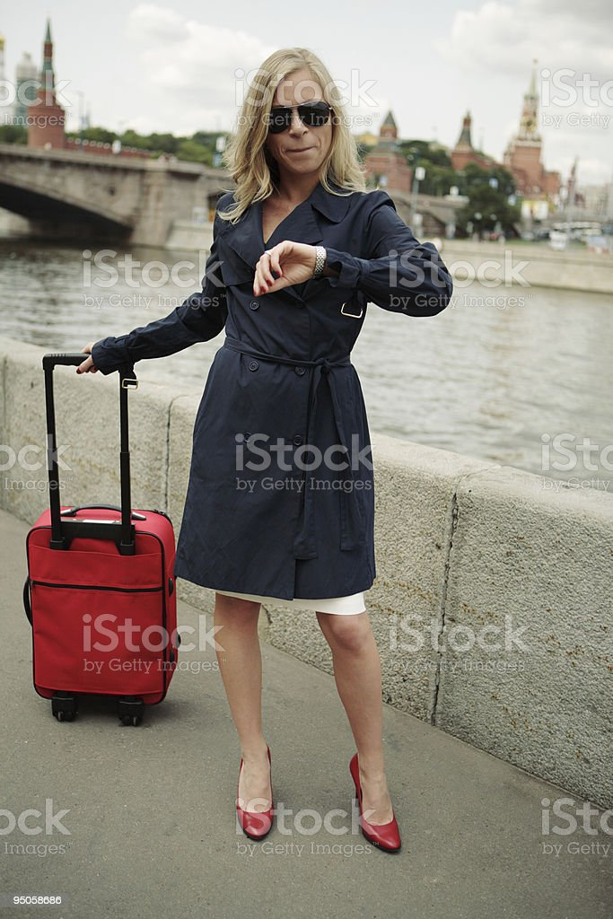 travelling woman checking time royalty-free stock photo