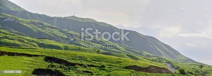 An asphalt road cross the treacherous mountainous landscape found on the island of Fogo, as it traverses through the village of Sao Jorge