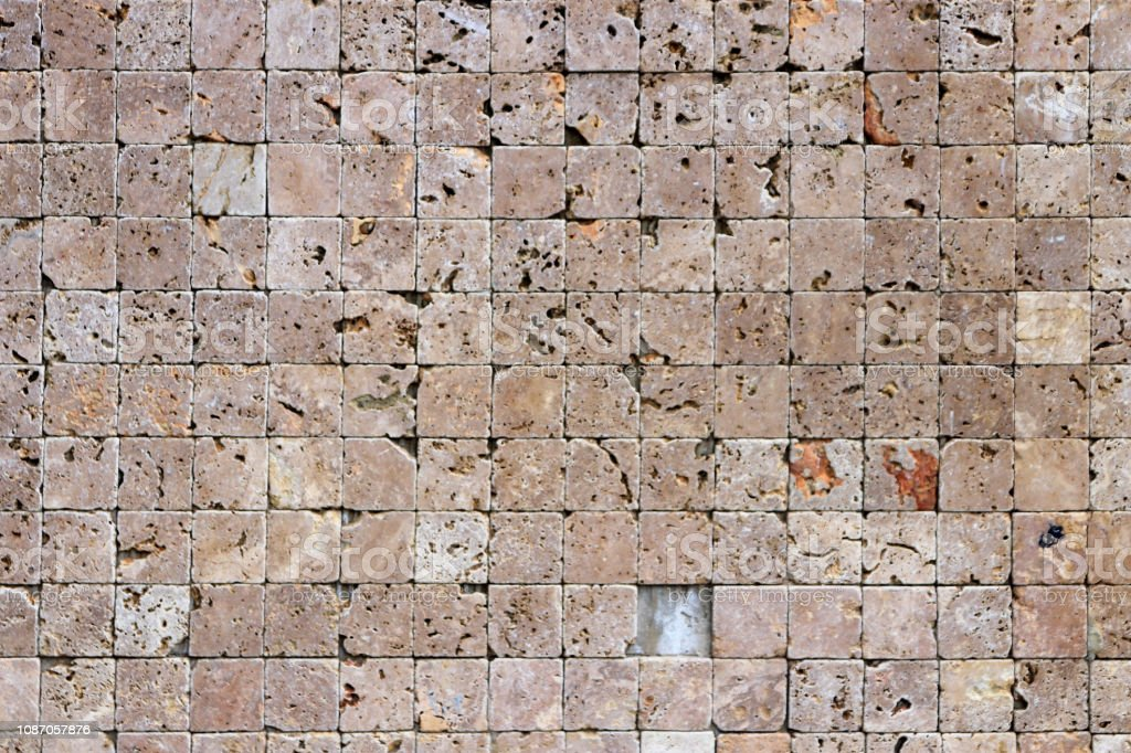 Travertine masonry tiles cladding wall texture. Square stones surface...