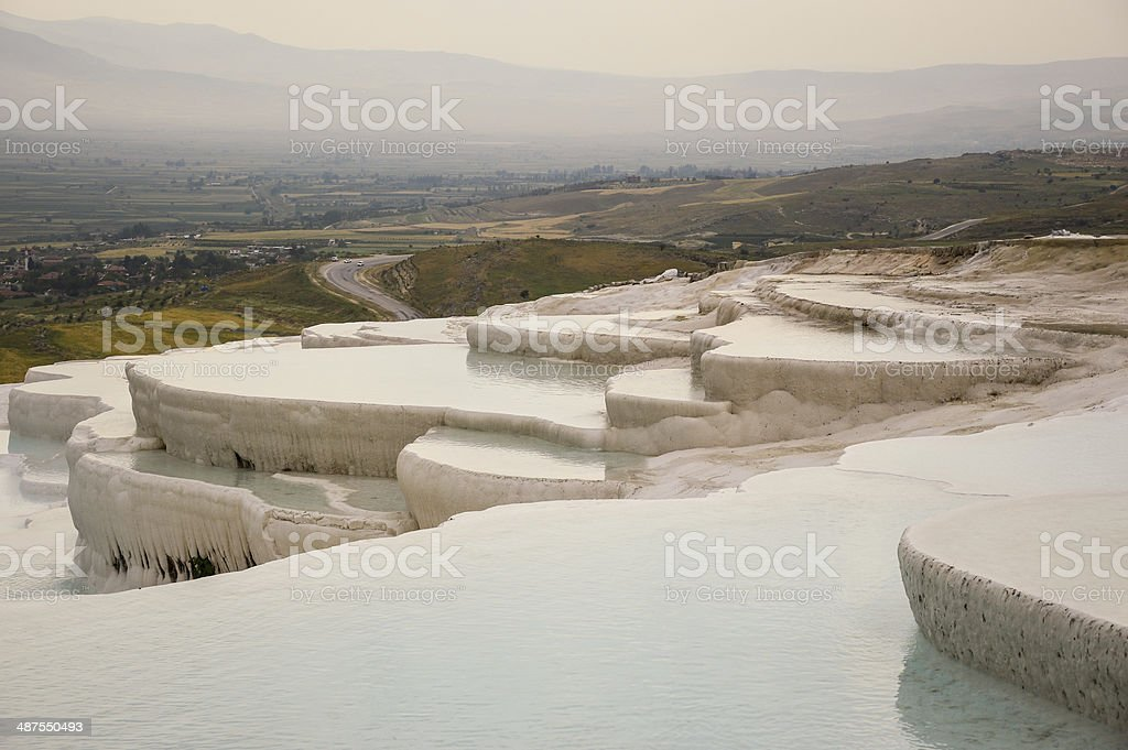 Travertine terraces filled with water stock photo