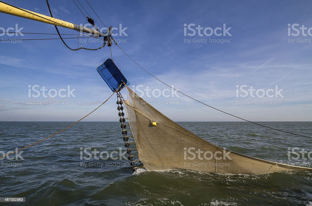 Trawl fishing net for shrimps dragging through sea stock photo