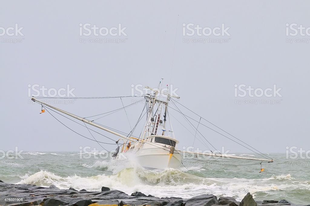 Trawler Entering Ocean City Harbor In Storm stock photo
