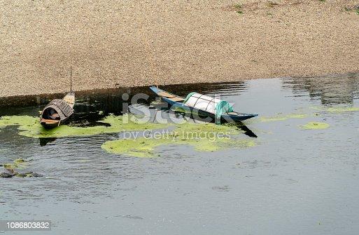 trawler resting on riverside