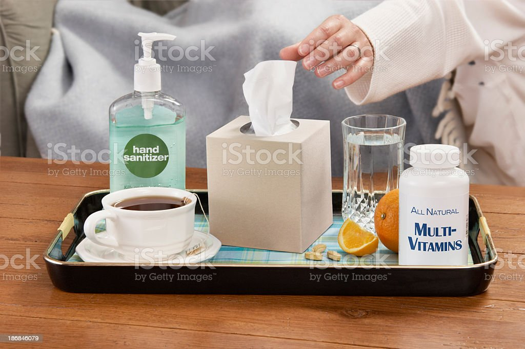 A tray of assorted cold and flu season necessities royalty-free stock photo