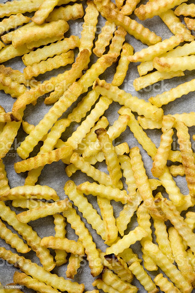 Tray of Crinkle Cut Oven Chips or Fries Overhead View stock photo