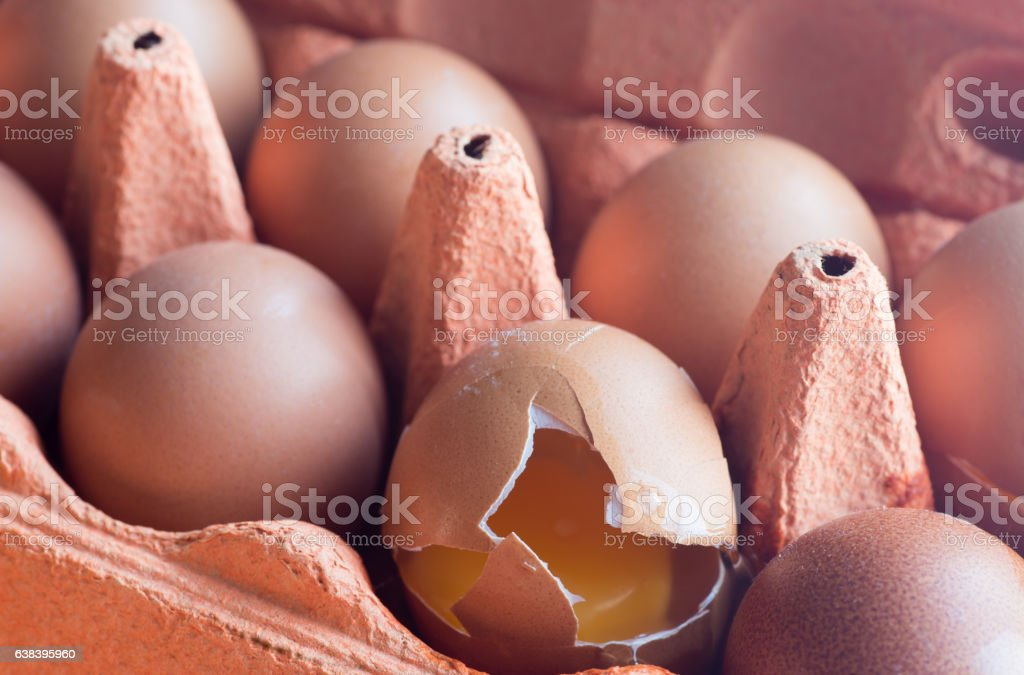 tray  of eggs, one broken stock photo
