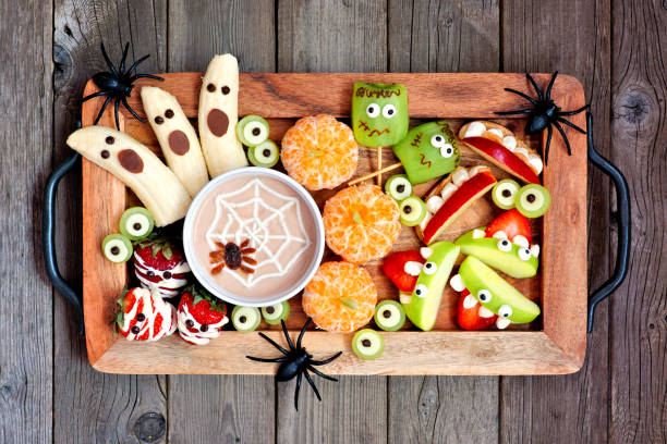 tray of healthy halloween fruit snacks, top view over a rustic wood background - happy halloween zdjęcia i obrazy z banku zdjęć