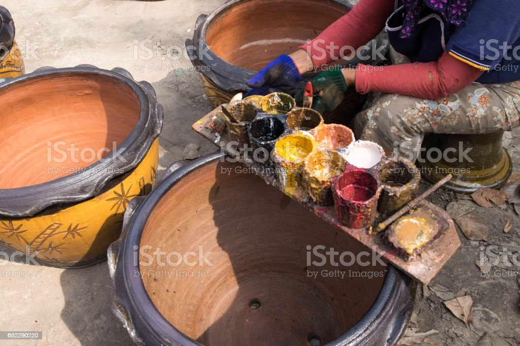 Tray of oil colors, use to fix damage of flower pots in pottery industry. stock photo