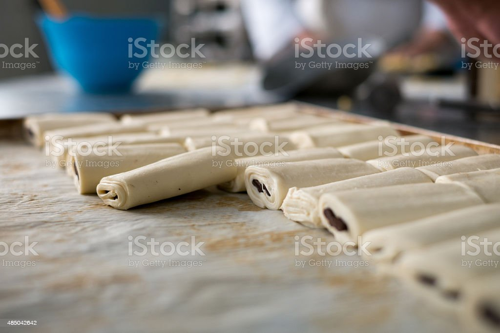 Tray of Rolled Chocolate Pastries Uncooked stock photo