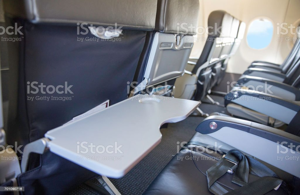 Tray table in down position on a airplane stock photo