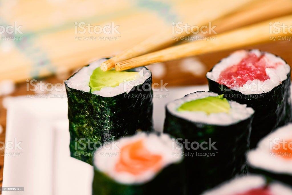 tray with an assortment of makizushi stock photo
