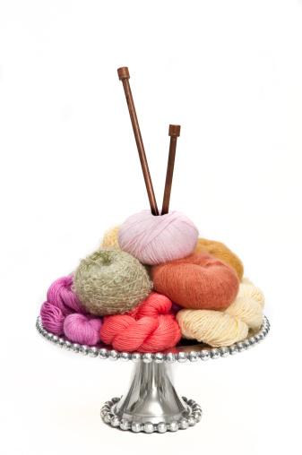 Tray with rolls of yarn
