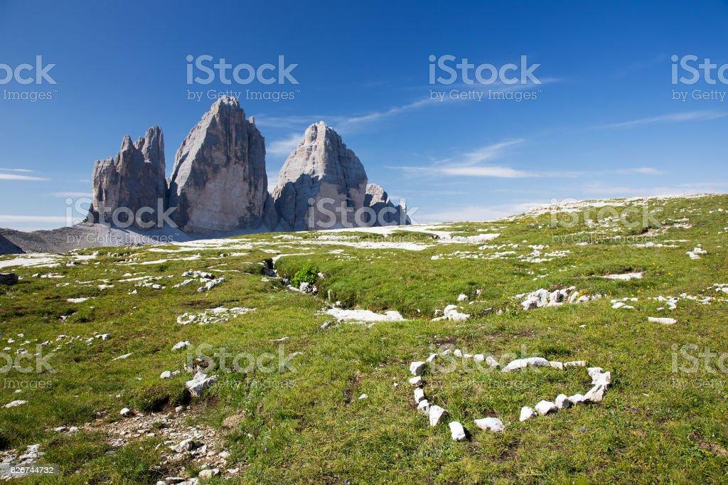 Tre Cime di Lavaredo - Italian Dolomites with heart of stones - love symbol stock photo