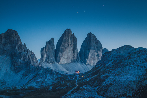 Tre Cime di Lavaredo mountain summits in the Dolomites at night, South Tyrol, Italy