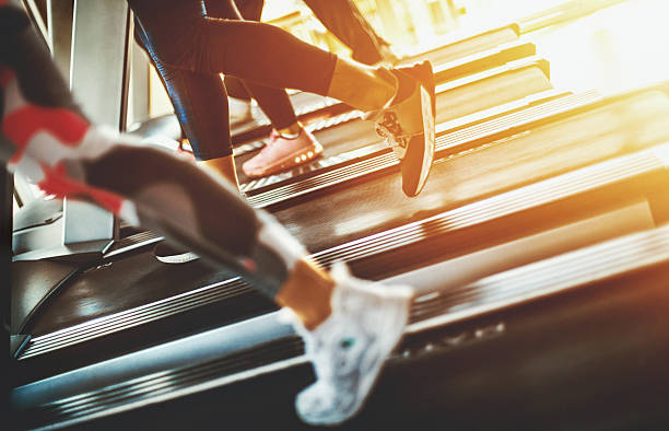 treadmill exercise. - health club stock photos and pictures