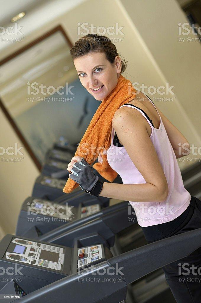 Treadmill Woman with Orange Towel royalty-free stock photo